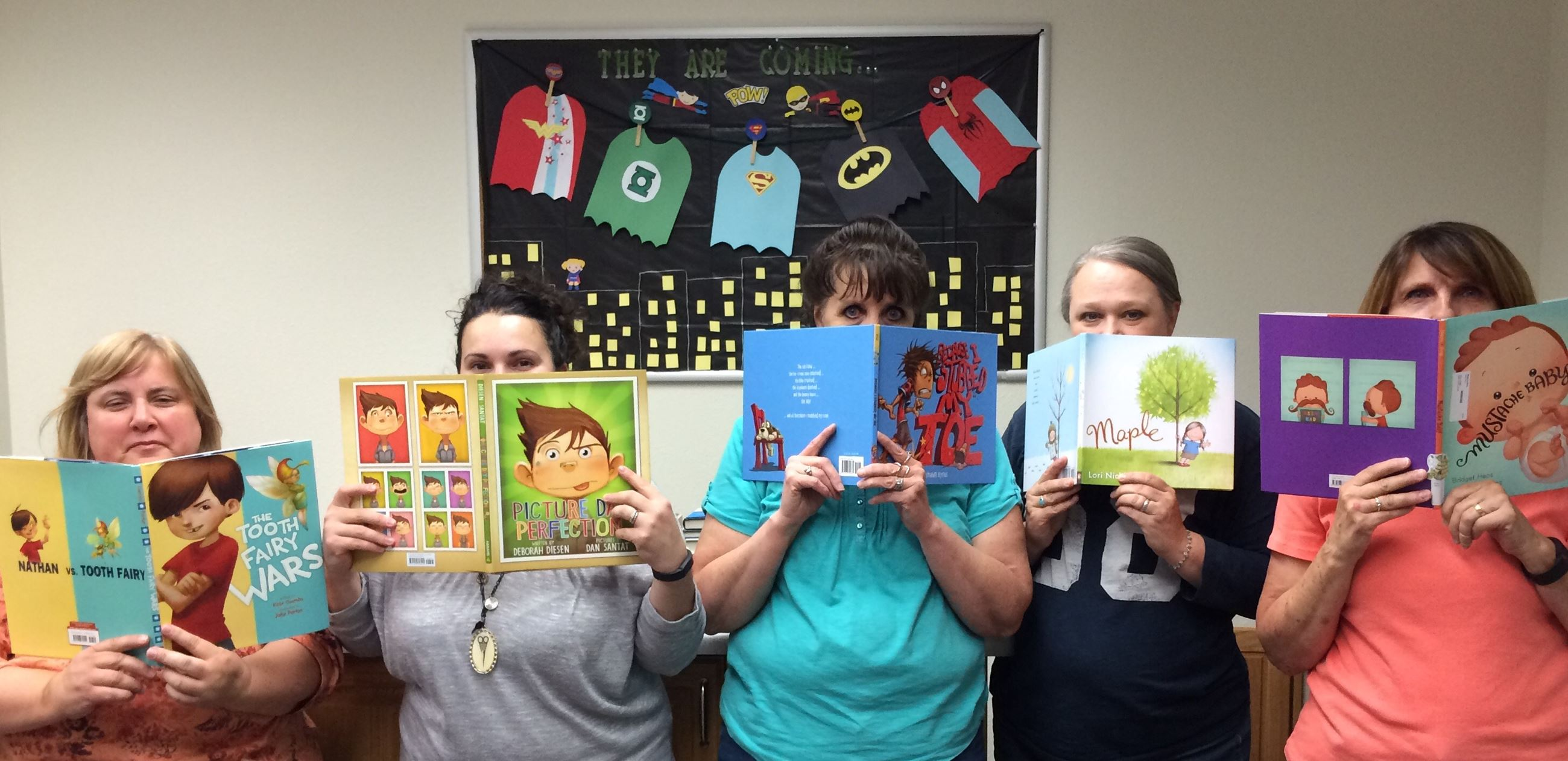 Librarians Holding Childrens Books